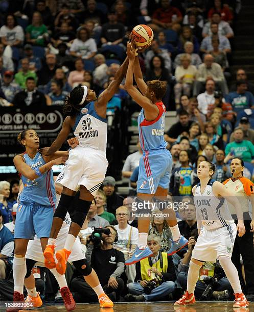 Rebekkah Brunson of the Minnesota Lynx blocks a shot by Angel McCoughtry of the Atlanta Dream as Erika de Souza of the Atlanta Dream and Lindsay...