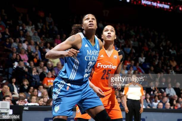 Rebekkah Brunson of the Minnesota Lynx boxes out against Alyssa Thomas of the Connecticut Sun during a WNBA game on May 26 2017 at the Mohegan Sun...