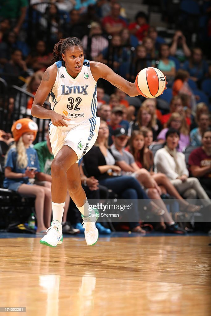 Rebekkah Brunson #32 of the Minnesota Lynx dribbles and looks to pass against the Phoenix Mercury during the WNBA game on July 24, 2013 at Target Center in Minneapolis, Minnesota.