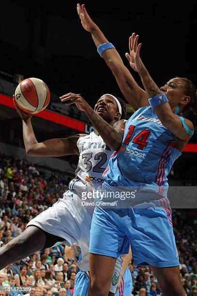 Rebekkah Brunson of the Minnesota Lynx goes for a layup against Erika de Souza of the Atlanta Dream during the WNBA game on September 7 2012 at...