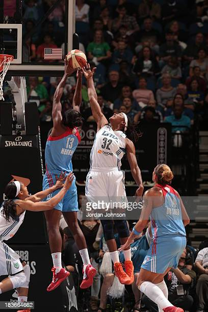 Rebekkah Brunson of the Minnesota Lynx goes for the rebound against Aneika Henry of the the Atlanta Dream during Game 2 of the 2013 WNBA Finals on...