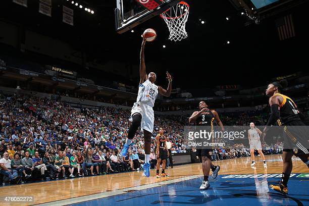 Rebekkah Brunson of the Minnesota Lynx goes to the basket against the Tulsa Shock during the season opener of their WNBA game on June 5 2015 at...
