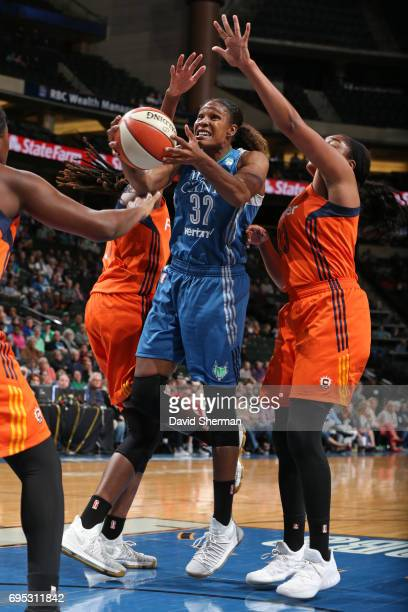 Rebekkah Brunson of the Minnesota Lynx goes to the basket against the Connecticut Sun on May 23 2017 at Xcel Energy Center in St Paul Minnesota NOTE...