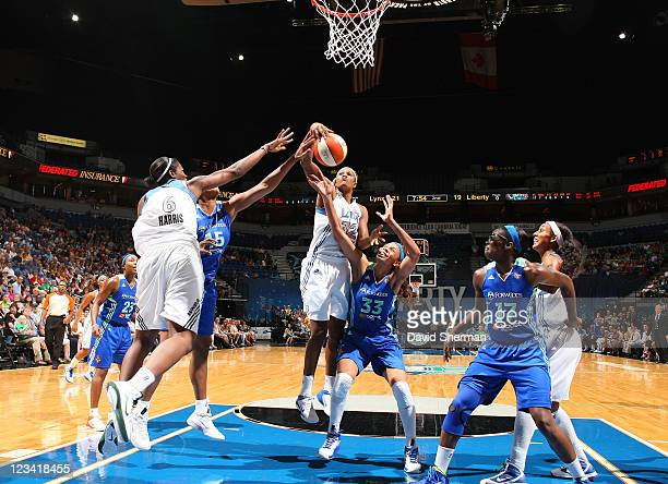 Rebekkah Brunson of the Minnesota Lynx grabs the rebound over Plenette Pierson of the New York Liberty during the game on September 2 2011 at Target...
