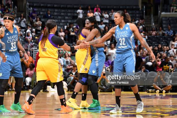 Rebekkah Brunson of the Minnesota Lynx high fives Odyssey Sims of the Los Angeles Sparks before the game during a WNBA game on August 27 2017 at...