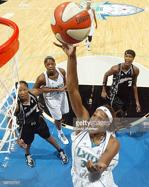 Rebekkah Brunson of the Minnesota Lynx lays up the shot against the San Antonio Silver Stars during the game on July 8 2010 at the Target Center in...