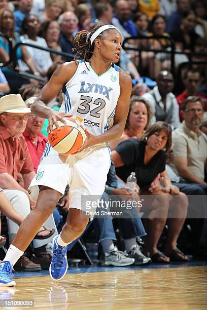 Rebekkah Brunson of the Minnesota Lynx looks to pass the ball in the WNBA game against the Tulsa Shock on August 31 2012 at Target Center in...