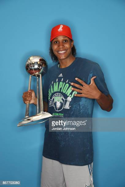 Rebekkah Brunson of the Minnesota Lynx poses for a portrait holding the championship trophy after defeating the Los Angeles Sparks in Game 5 of the...