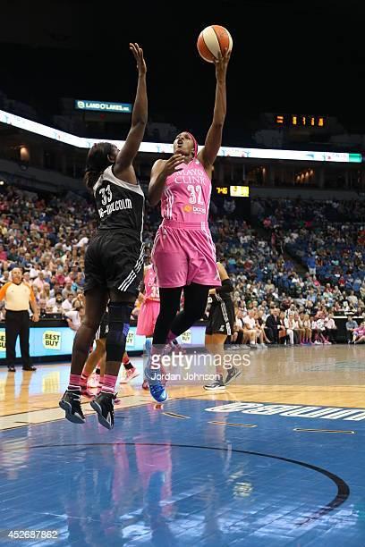 Rebekkah Brunson of the Minnesota Lynx shoots against Sophia YoungMalcom of the San Antonio Stars during the WNBA game on July 25 2014 at Target...
