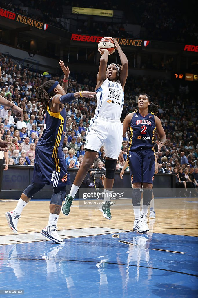 Rebekkah Brunson #32 of the Minnesota Lynx shoots the ball against Shavonte Zellous #1 of the Indiana Fever during the 2012 WNBA Finals Game Two on October 17, 2012 at Target Center in Minneapolis, Minnesota.