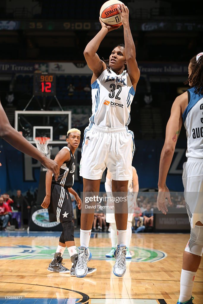 Rebekkah Brunson #32 of the Minnesota Lynx shoots the basketball against the San Antonio Silver Stars during the WNBA game on June 11, 2013 at Target Center in Minneapolis, Minnesota.