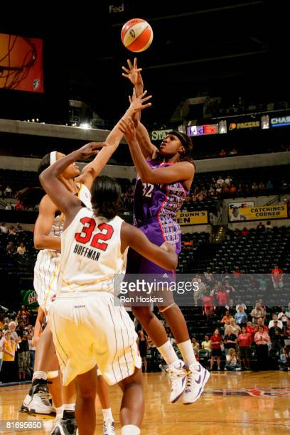 Rebekkah Brunson of the Sacramento Monarchs shoots over Tammy SuttonBrown and Ebony Hoffman of the Indiana Fever at Conseco Fieldhouse June 24 2008...
