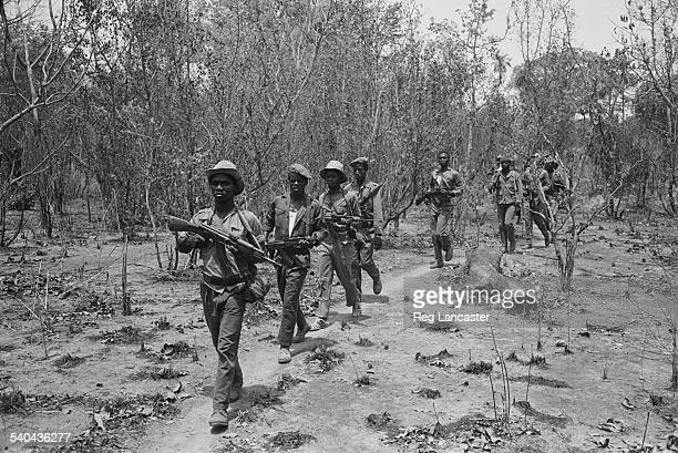 A rebel army on patrol armed with some of the issued range of Russian weapons during the Portuguese Colonial War GuineaBissau West Africa 1972