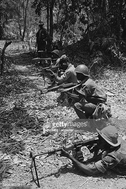 A rebel army on patrol with some of the issued range of Russian weapons including machine guns assault rifles and a bazooka during the Portuguese...