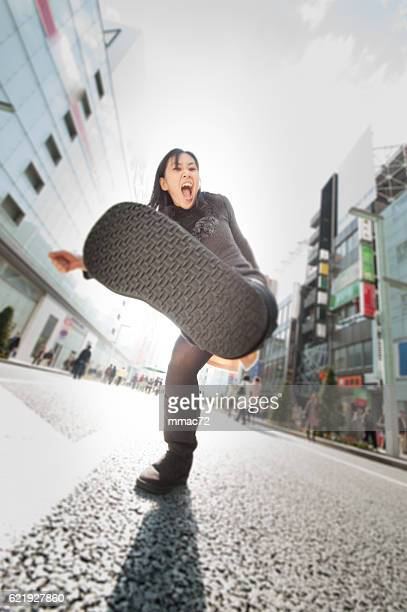 rebel asian woman in backlight - japanese women feet stock photos and pictures