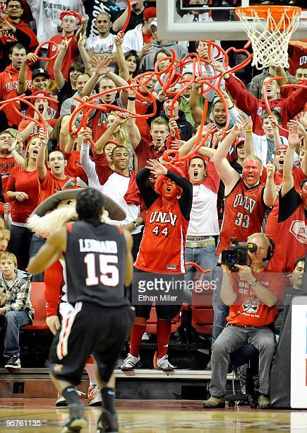 Rebel fans try to distract Kawhi Leonard of the San Diego State Aztecs as he shoots a free throw during a game at the Thomas Mack Center January 13...