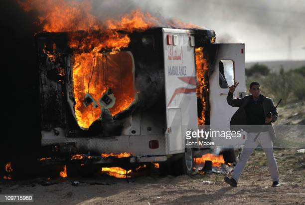 Rebel fighter advances on the front line against Libyan government forces on March 2, 2011 in al-Brega, Libya. The rebels drove out troops loyal to...