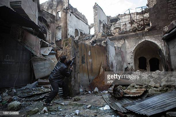 A rebel fighter fires towards Syrian government forces in the Bab alNasr district of Aleppo's Old City on January 7 2012 Syria's domestic opposition...