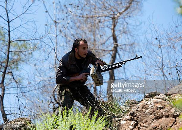 A rebel fighter from the alEzz bin Abdul Salam Brigade attends a training session at an undisclosed location near the alTurkman mountains in Syria's...