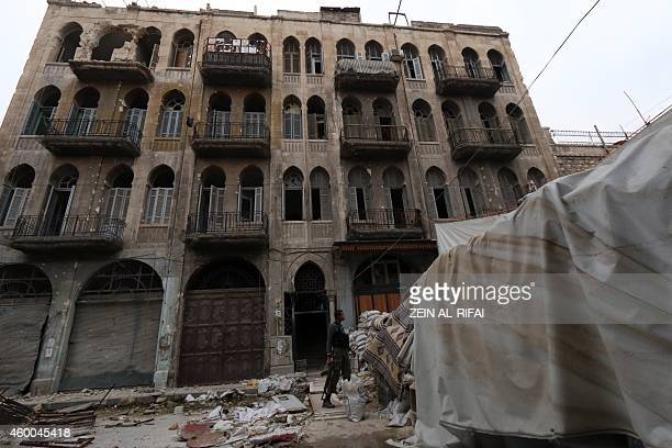 A rebel fighter monitors a street in the old city of Aleppo on December 6 2014 Aleppo Syria's second city and former industrial powerhouse has been...