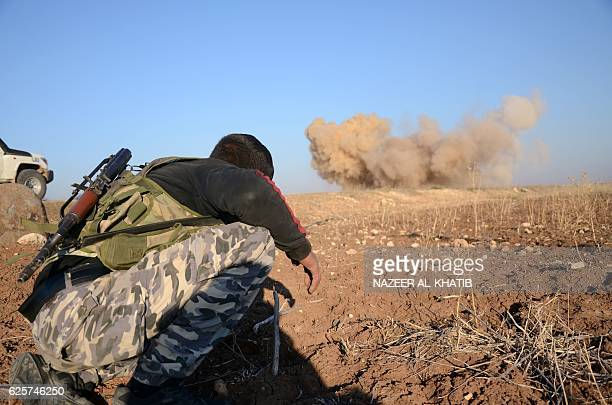 TOPSHOT A rebel fighter reacts as a landmine planted by Islamic State group jihadists is exploded by his comrades in the village of Tilalayn on the...
