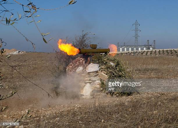 Rebel fighters fire rockets towards a proregime position on February 20 2014 in the countryside near the Syrian city of Hama Syrian rebels were...