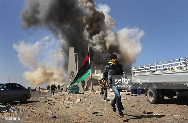 Rebel fighters flee a government airstrike on the frontline on March 11 2011 in Ras Lanuf Libya Government troops loyal to Libyan leader Moammar...