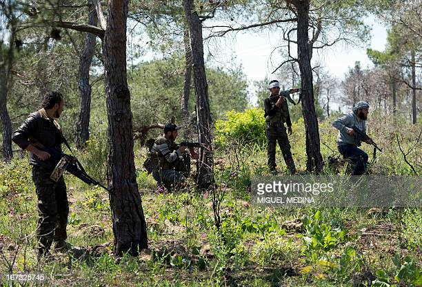 Rebel fighters from the AlEzz bin Abdul Salam Brigade attend a training session at an undisclosed location near the alTurkman mountains in Syria's...