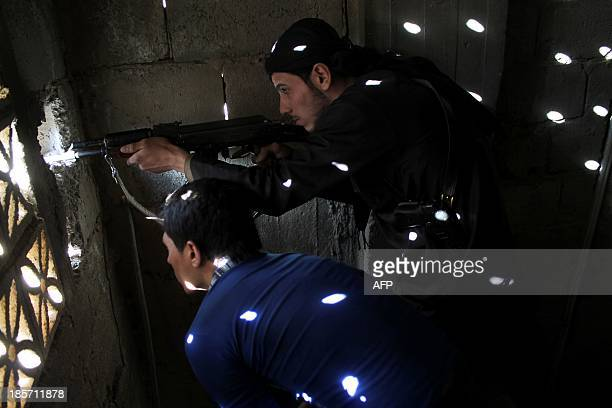 Rebel fighters hold a position on the front line in the Syrian northeastern city of Deir Ezzor on October 24 2013 Syria is set to hand over a...