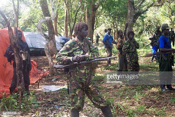 Rebel fighters of Uganda's Lord's Resistance Army gather to accompany their leader Joseph Kony to a meeting with Jan Egeland, the United Nations...