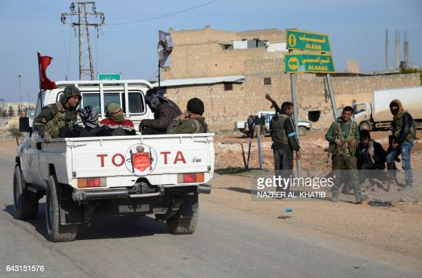 Rebel fighters part of the Turkeybacked Euphrates Shield alliance advance on February 20 towards the city of AlBab some 30 kilometres from the Syrian...