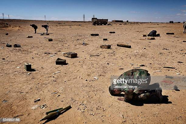 Rebel fighters pray near the front lines Libyan rebels fought a bloody 9 month war that eventually toppled the Gaddafi regime Photo by Sebastian Meyer