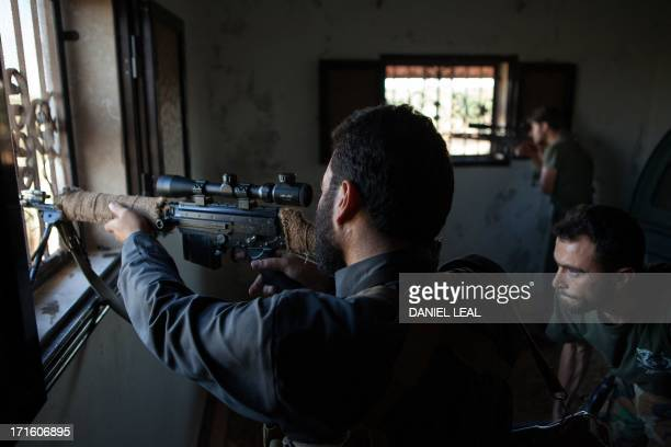Rebel fighters take aim at government forces positioned in the northern Syrian town of AlFawaa located northeast of Idlib on June 26 2013 More than...