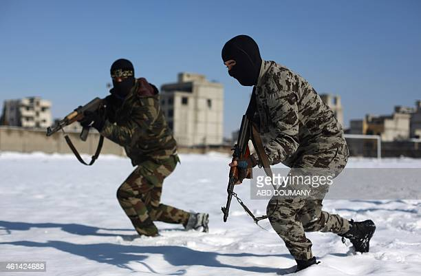 Rebel fighters with the Jaish alIslam run with their rifles during a training session in Eastern alGhouta a rebelheld region outside the capital...