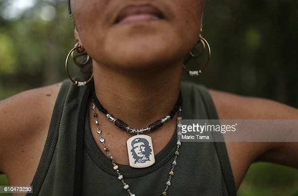 rebel Gina poses while wearing a Che Guevara necklace following the 10th Guerrilla Conference in the remote Yari plains where the peace accord was...