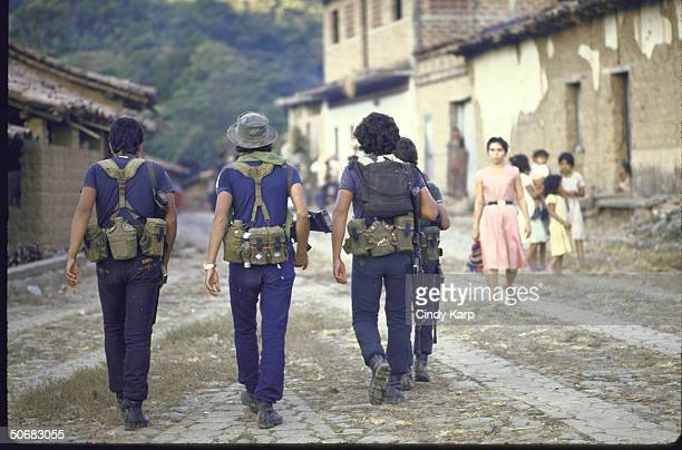 Rebel guerrillas patrolling a village