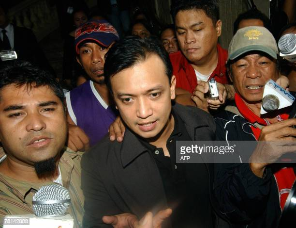 Rebel leader Antonio Trillanes a navy lieutenant who was elected a senator speaks to journalists while holed up at the luxury hotel in Manila's...