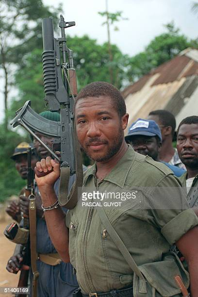 Rebel leader Charles Taylor holds his Sovietmade AK47 assault rifle in Buchanan 29 May 1990 as he continues his march on the capital Monrovia to oust...