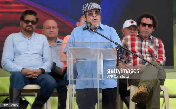 FARC rebel leader Rodrigo Londono Echeverri known as 'Timochenko' delivers a speech during the final act of abandonment of arms and the FARC's end as...