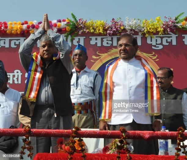 JD rebel leader Sharad Yadav along joining hands with Prakash Ambedkar and other leaders during ' lathi Rally' organised by Akhil Bhartiya Mahatma...