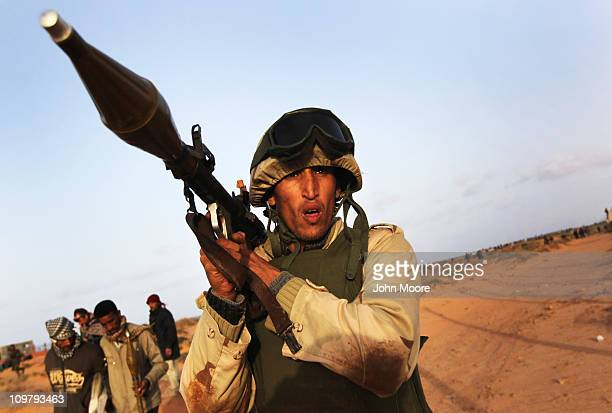 Rebel militiaman advances on the front line with government troops March 25 2011 in Ben Jawat, Libya. Opposition forces pushed government troops...
