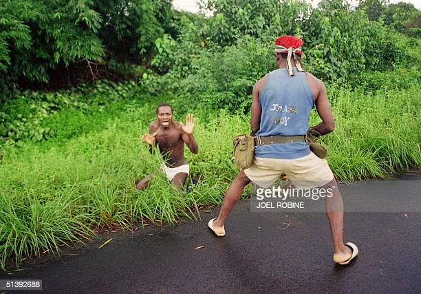 A rebel of Charles Taylor's National Patriotic Front of Liberia fire 03 August 1990 in Bentol on student William Weah executing him after roadside...