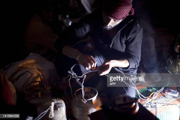A rebel of the Free Syrian Army who have found refuge in the mountains close to AlJanoudia village in Idlib province in northern Syria on March 17...