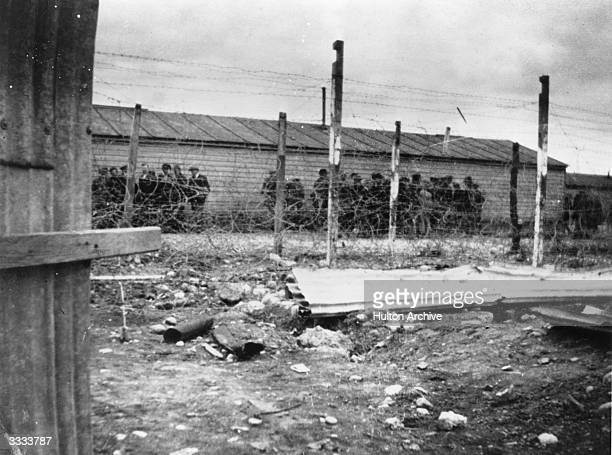 Rebel Sinn Fein leaders behind barbed wire in an internment camp 'somewhere in the heart of Ireland' following the Easter Rising in Dublin.