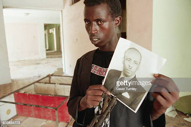 A rebel soldier holds a photograph of Muhammad Siad Barre the overthrown dictator who ruled Somalia for 21 years The picture was found on the floor...