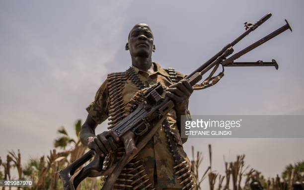 TOPSHOT A rebel soldier poses with his gun in Touch Riak Leer county on March 7 where famine has been declared since February 2017 International NGOs...
