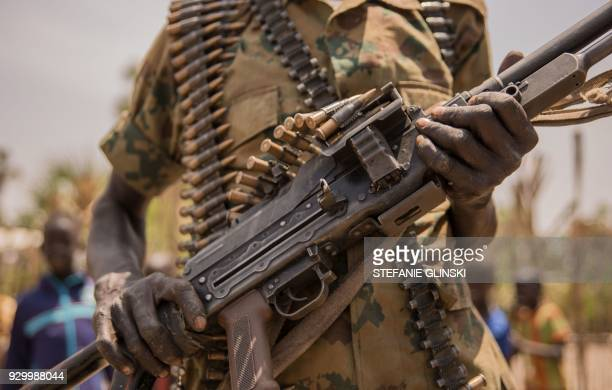 A rebel soldier poses with his gun in Touch Riak Leer county on March 7 where famine has been declared since February 2017 International NGOs have...