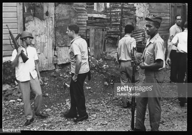 Rebel soldiers patrol a poor area of Santo Domingo to protect the tin shacks from Junta mortar fire