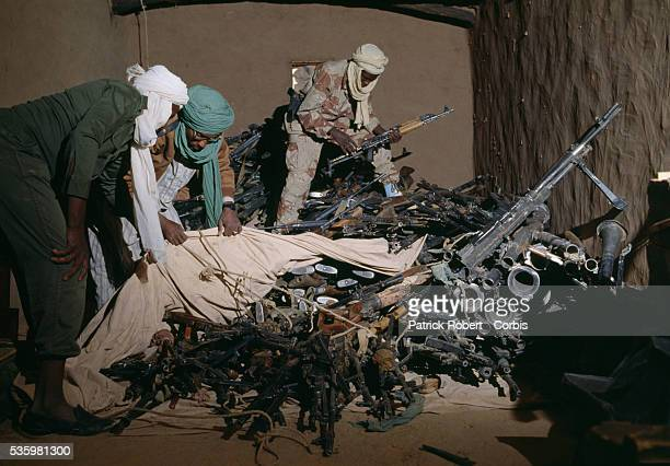 Rebel soldiers with the Forces Armées Nationales Chadiennes or National Army of Chad search a weapons cache after fighting between Idriss Deby's...