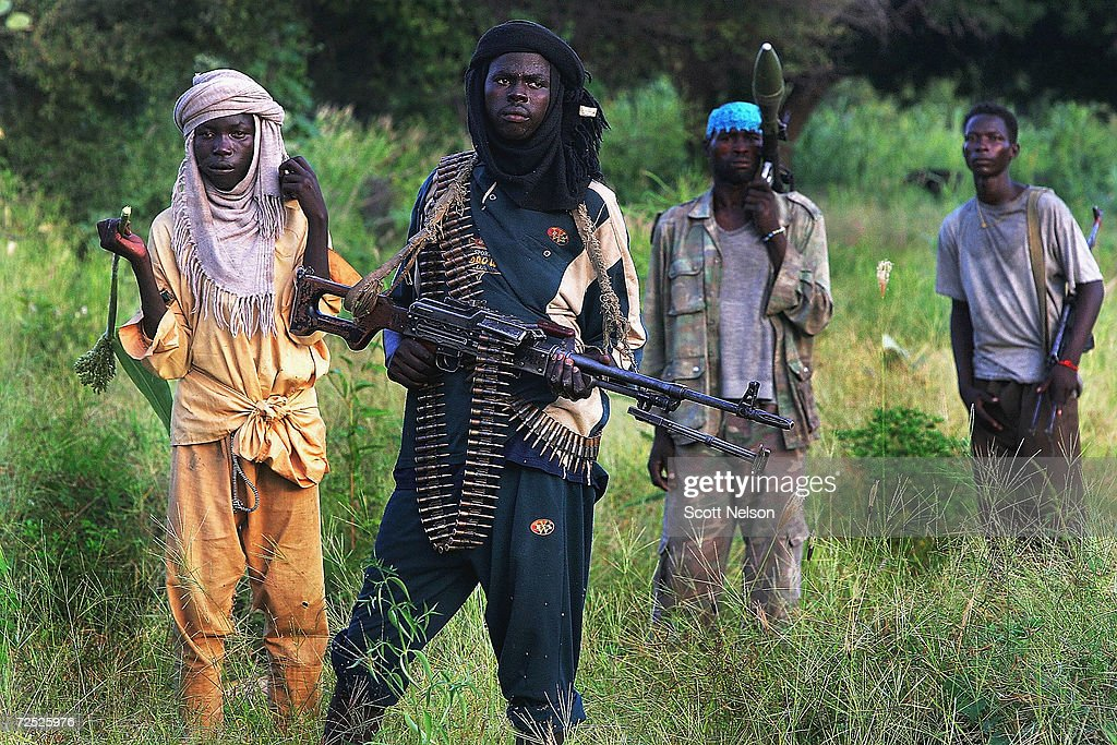 Rebel Sudanese Justice and Equality Movement (JEM) fighters investigate an abandoned village looted and burned by government supported Janjaweed militiamen near their base in the Darfur region of Sudan, September 7, 2004. in Ulang, Sudan. . Both rebel groups, the JEM, and the Sudanese Liberation Movement (SLM) continue to abide by a current ceasefire and are participating in talks with the Sudanese government in neighboring Nigeria, but are growing increasingly frustrated by the government's failure to reign in the janjaweed militia and warn of impending military action if the violence in the region does not end soon.